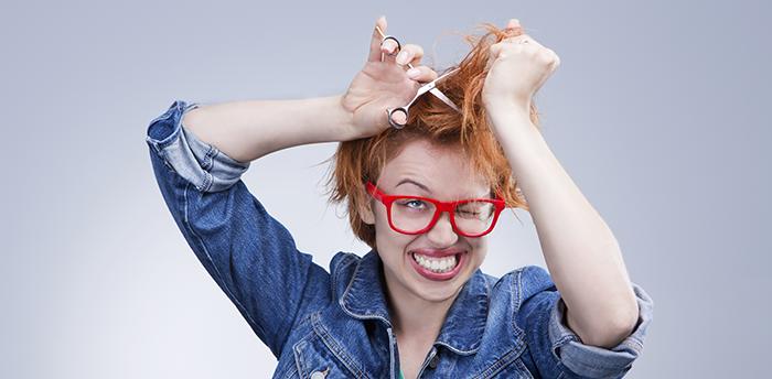 Woman cutting her own hair